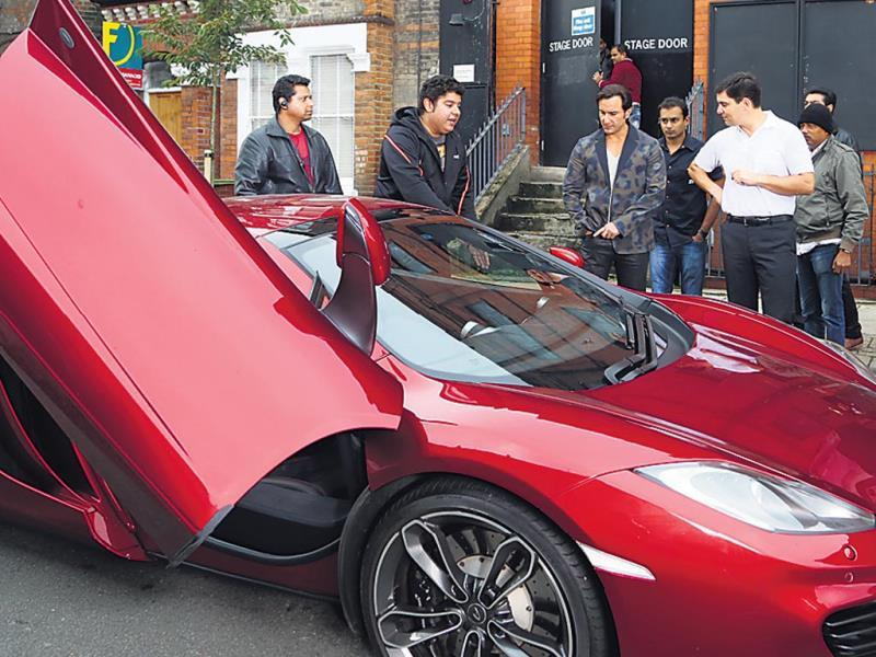 We're informed that Saif, who loves expensive and fancy cars, was delighted at the sight of a rare sports car, which was on display at a showroom. (HT Photo)