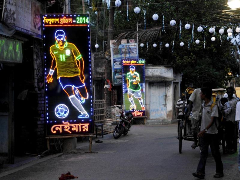 Roads and bylanes being decorated with flags of participating countries and colorful flex of the players at Ganguly Bagan in South Kolkata on the eve of World Cup 2014. (Subhendu Ghosh/HT Photo)