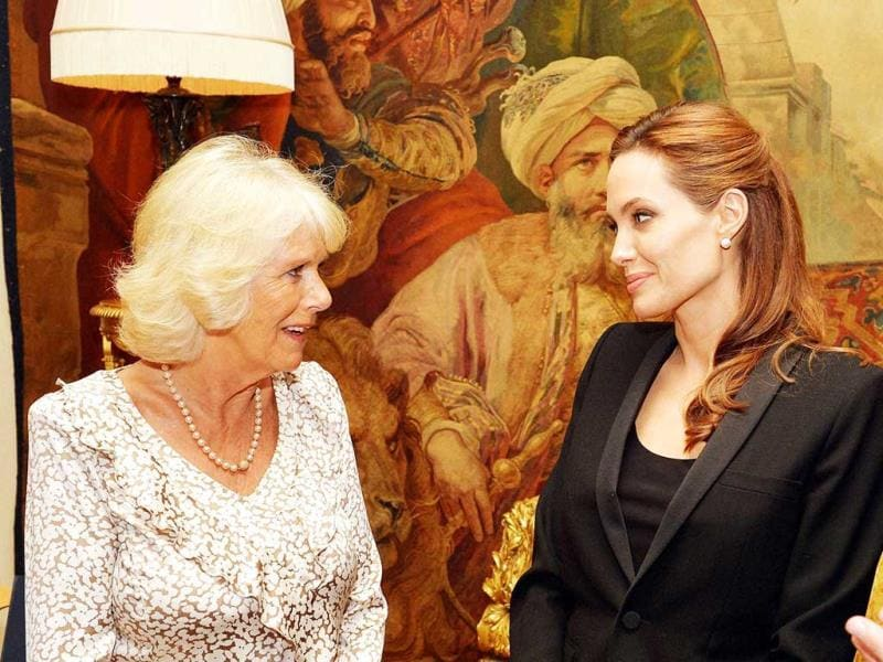 Camilla, Duchess of Cornwall meets Angelina Jolie, as the actor talked about her campaign against sexual violence in war zones during a meeting, at Clarence House, London. AFP Photo