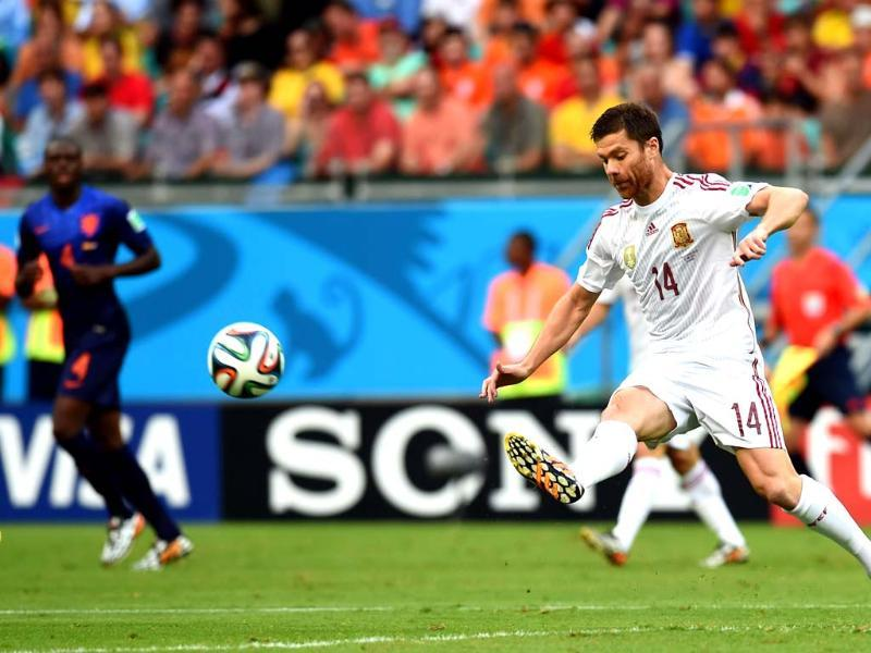 Spain's midfielder Xabi Alonso in action. He scored a penalty to give the world champions the lead in the 27th minute. (AFP Photo)