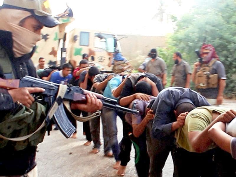 This image appears to show ISIS militants leading away captured Iraqi soldiers. Foreign fighters from dozens of nations are pouring into the West Asia to join the Sunni militants. (AP/PTI Photo)