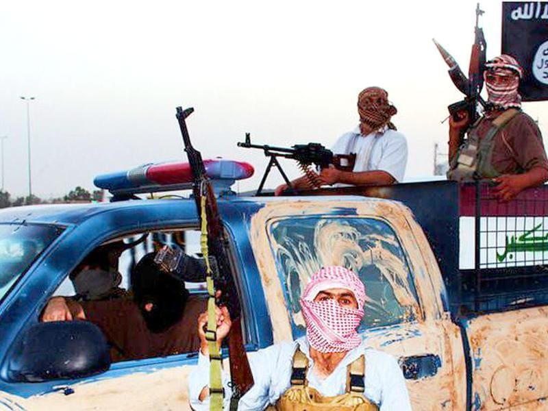An image uploaded on June 14 on the jehadist website Welayat Salahuddin allegedly shows militants of the Islamic State of Iraq and the Levant (ISIL) riding in a captured vehicle left behind by Iraqi security forces at an unknown location in the Salaheddin province. A major offensive spearheaded by ISIL but also involving supporters of executed dictator Saddam Hussein has overrun all of one province and chunks of three others since it was launched on June 9. AFP Photo/HO/Welayat Salahuddin