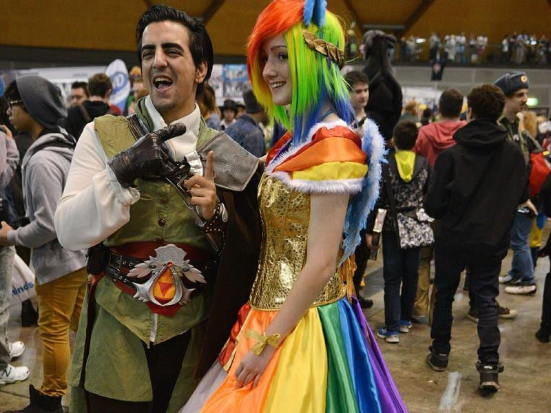 People dressed in costume pose for photos as they attend the Supanova Pop Culture Expo in Sydney. (AFP photo)