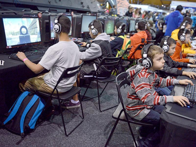 Gamers play video games as they attend the Supanova Pop Culture Expo in Sydney. (AFP photo)