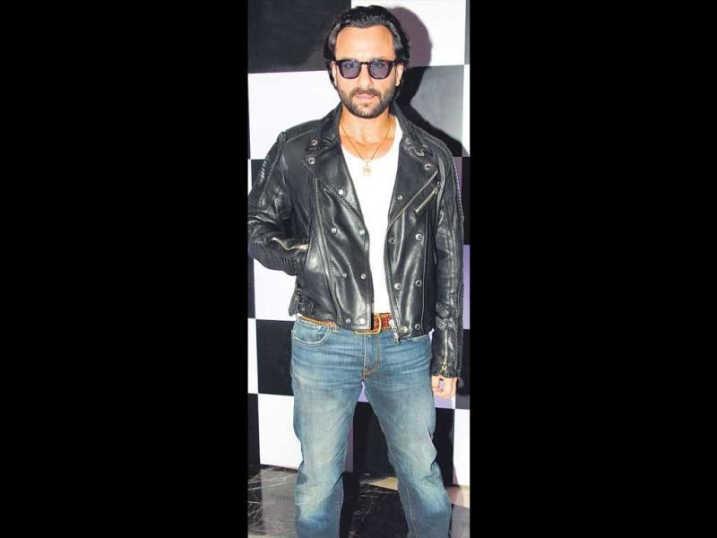 Saif Ali Khan wore a leather jacket and even sunglasses indoors at an event. HT Photo/Yogen Shah