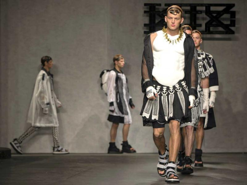 Models wearing black and white skirts, neckpieces and other 'feminine accessories' present creations from KTZ during its London Collections: Men show in London. (Reuters)