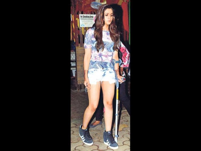 Alia Bhatt walks with a forearm crutch due to a recent injury. (Photo: Yogen Shah)