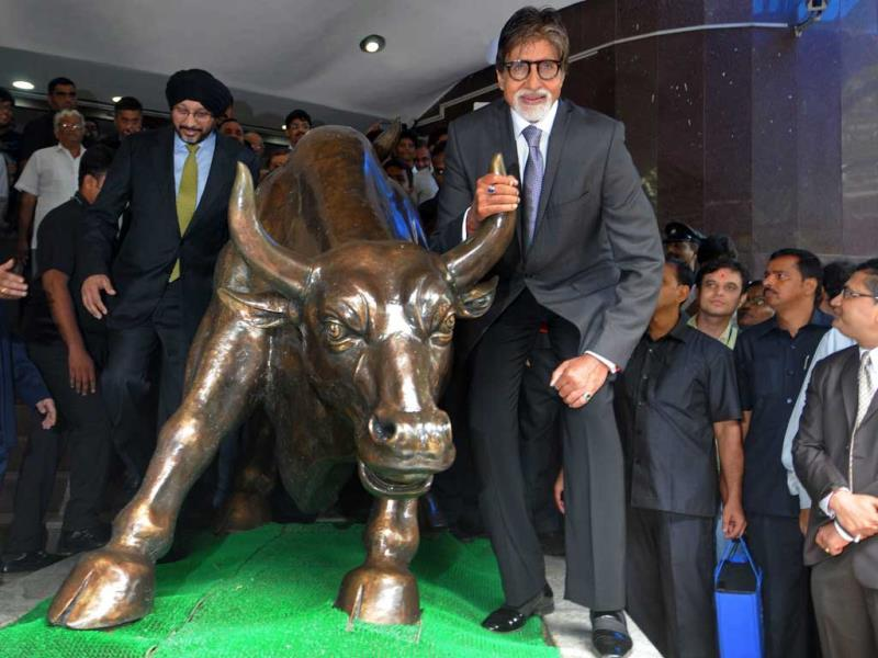 Amitabh Bachchan poses with the bull statue at BSE during a promotional event of his TV show Yudh. (PTI Photo)