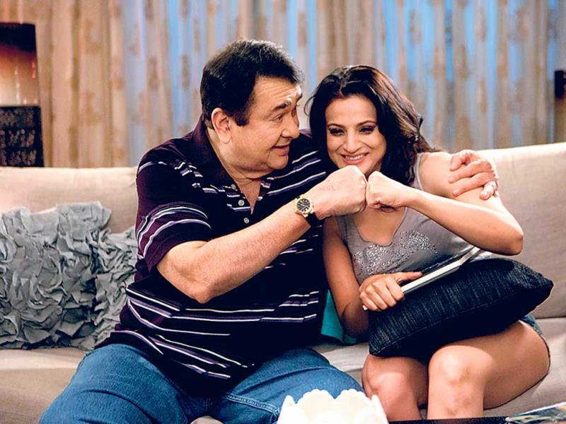 Actors Randhir Kapoor and Ameesha Patel were caught in a candid moment on the sets of their upcoming film, Desi Magic.