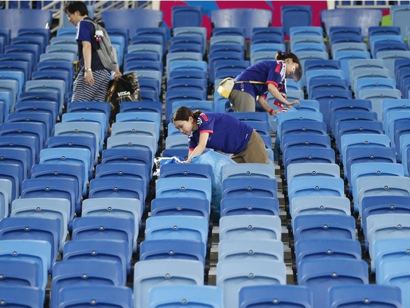Brazil, Natal: June 19, 2014 Japanese fans clean up the stadium after their 2014 World Cup Group C soccer match against Japan and Greece at the Dunas arena in Natal. (REUTERS/TORU HANAI)