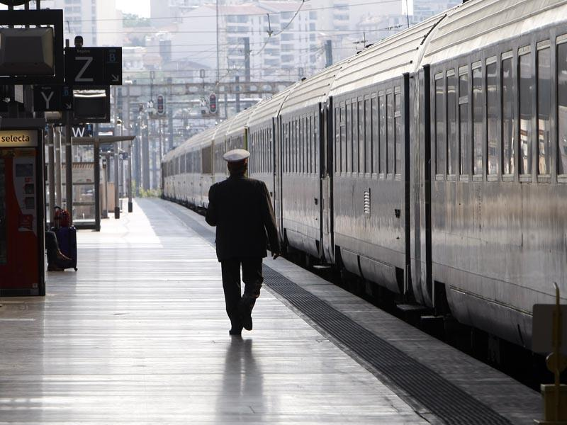 France, Marseille: June 17, 2014  An employee of French national railway SNCF walks on a platform at Saint-Charles railway station, in Marseille, southern France. A weeklong strike by rail workers has caused one of the worst disruptions to the country's rail network in years. (AP PHOTO/CLAUDE PARIS)