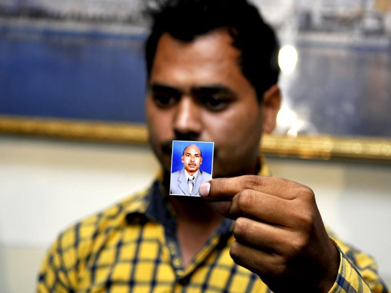 Family member of one of the Indians who has reportedly been abducted in Iraq, holding a photograph of his kin during a visit to Rakab Ganj Gurudwara, in New Delhi. (Sonu Mehta/ HT Photo)