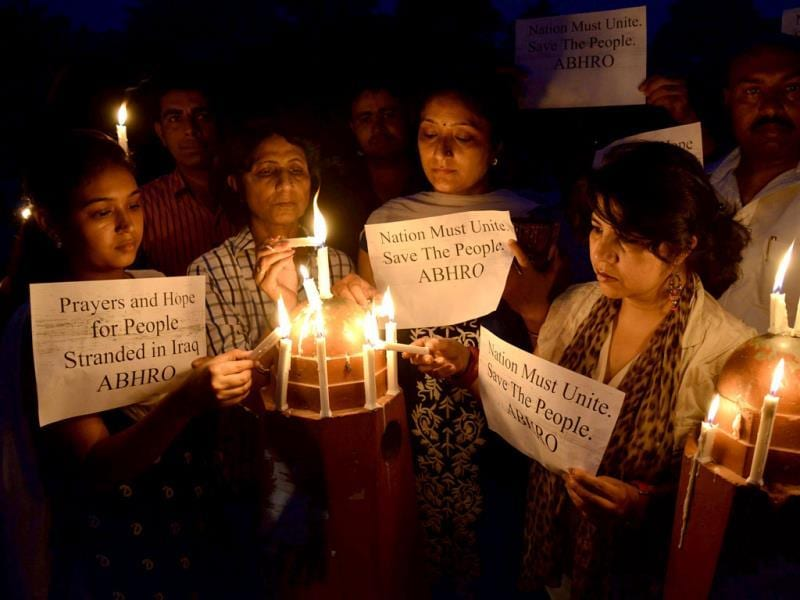 Members of Akhil Bhartiya Human Rights Organisation (ABHRO) hold candles and placards as they demonstrate for the early release of 40 Indian workers abducted in Iraq, in Amritsar. (AFP Photo)