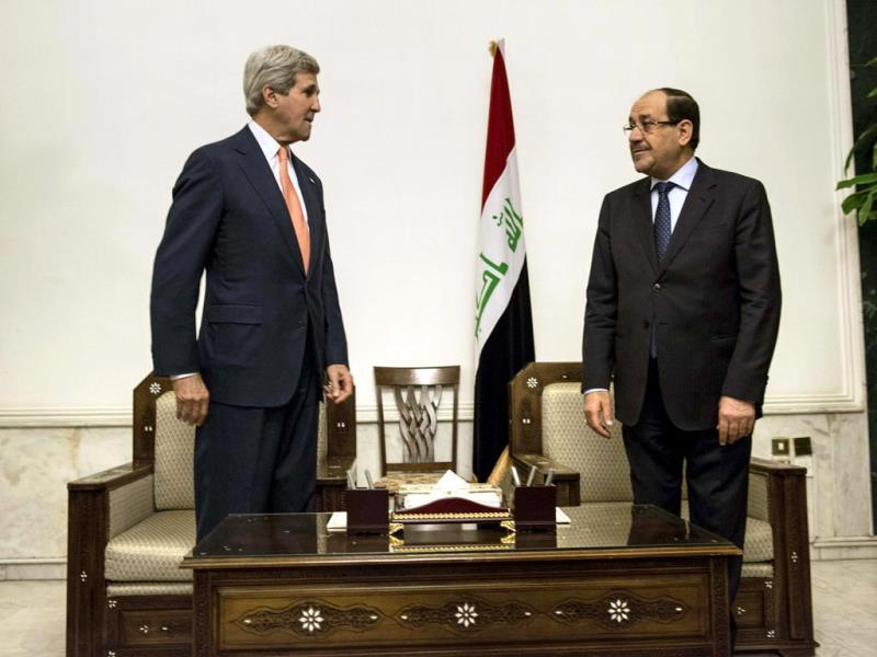 Iraqi Prime Minister Nuri al-Maliki and John Kerry meet at the Prime Minister's ofice in Baghdad. (Reuters photo)