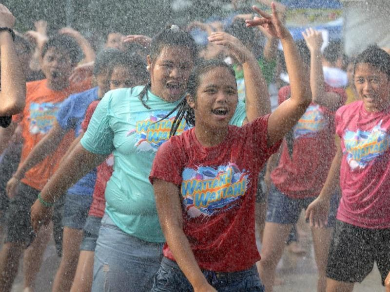 Residents are sprayed with water as they celebrate the feast day of St John the Baptist in Manila. Residents traditionally greet everyone with splashing water in a belief that it is a way of spreading good blessings on St John's Day. (AFP photo)