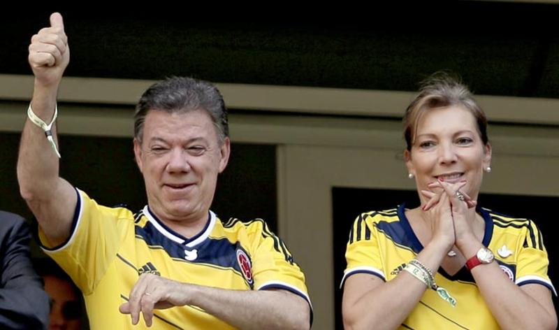 Columbia vs Ivory Coast - June 19, 2014  Colombian President Juan Manuel Santos, with his wife, Maria Clemencia Rodriguez, gesture before the start of the group C World Cup football match between Colombia and Ivory Coast in Brasilia, Brazil. (AP/Marcio Jose Sanchez)