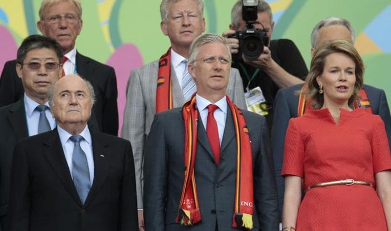 Belgium vs Russia - June 22, 2014  Belgium's Queen Mathilde and Belgium's King Philippe stand for the national anthems before the group H World Cup soccer match between Belgium and Russia in Rio de Janeiro, Brazil. (AP/Ivan Sekretarev)