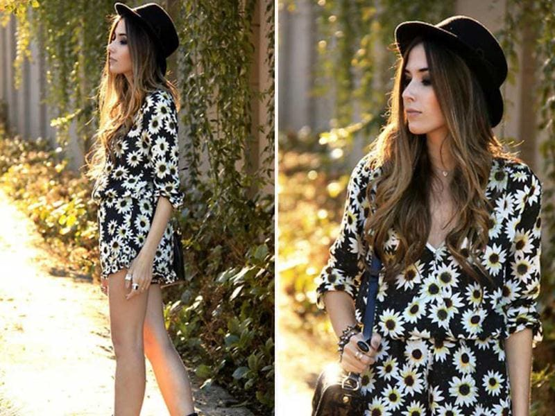 A floral sundress with a classic black hat.
