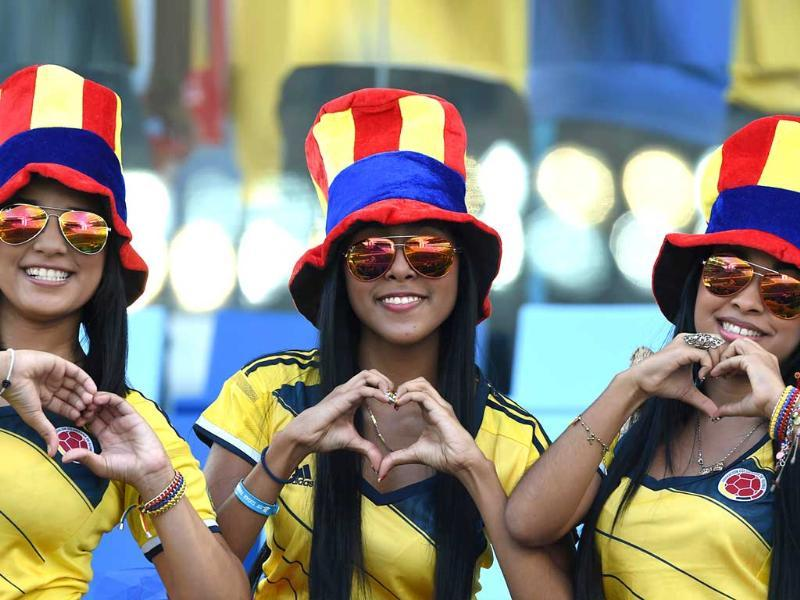 Colombia's fans pose for a photo prior to their Group C match against Japan at the Pantanal Arena in Cuiaba. (AFP Photo)