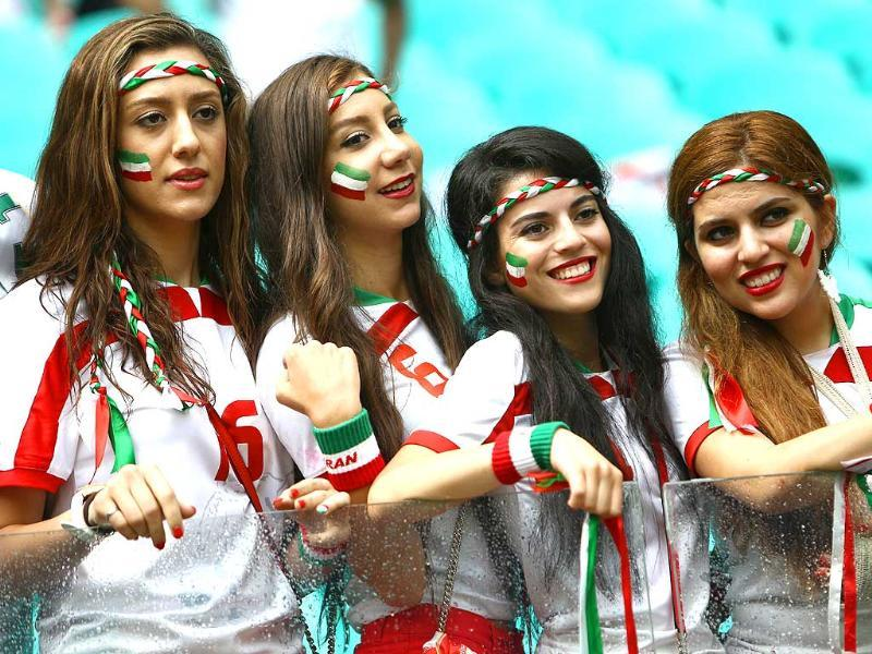 Iran fans pose during a Group F match between Bosnia-Hercegovina and Iran at the Fonte Nova Arena in Salvador. (AFP Photo)