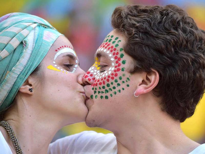 Portugal's fans kiss prior to their Group G match against Ghana at the Mane Garrincha National Stadium in Brasilia. (AFP Photo)