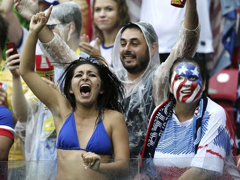 US fans celebrate after their team advanced to the round of 16 despite losing 0-1 to Germanyin Recife, Brazil. (AP Photo)