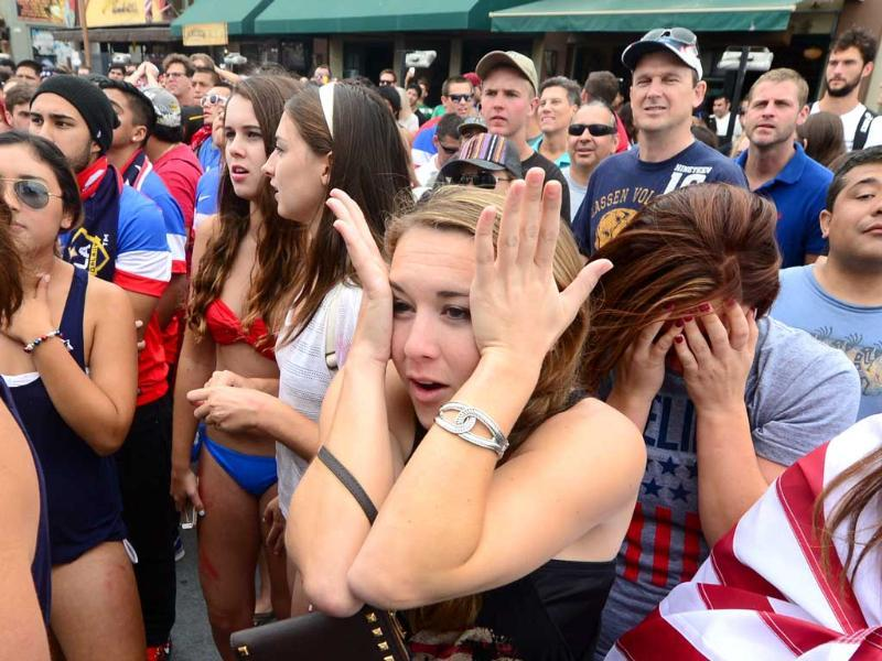 US fans watching from Hermosa Beach, California react to Thomas Muller's goal for Germany against the United States during their first round match. (AFP Photo)