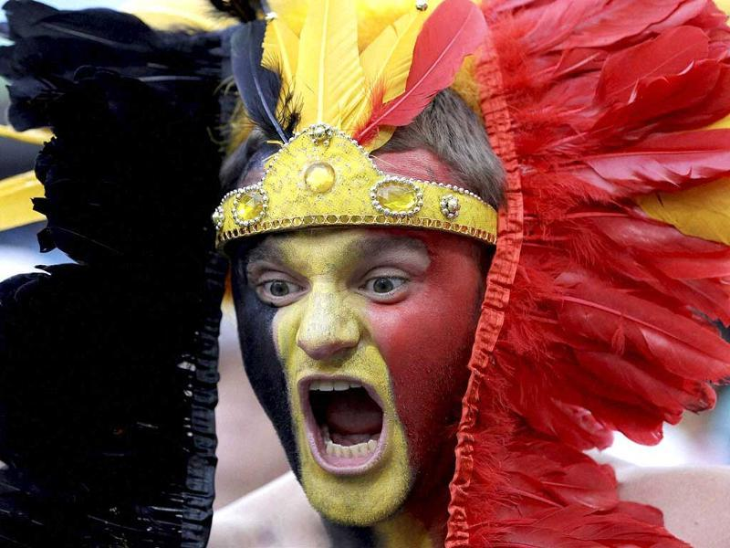 A Belgian fan cheers for his national team before the Group H World Cup match between South Korea and Belgium at the Itaquerao Stadium in Sao Paulo. (AP Photo)