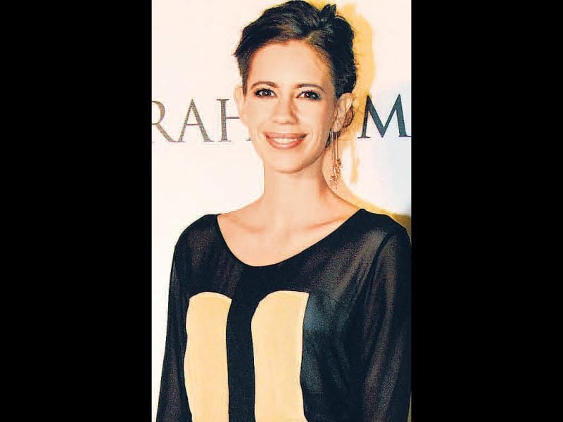 Kalki Koechlin looked chic in a long-sleeved sheer top and grey skirt, that she paired with golden earrings at a stylish evening in Mumbai.