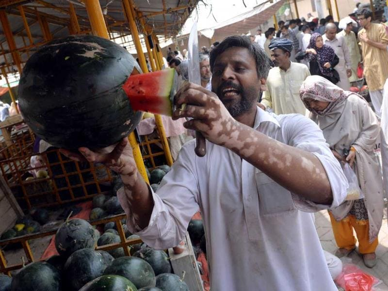 A Pakistani vendor sells watermelon at a weekly bazaar ahead on the first day of Ramadan. (AFP photo)