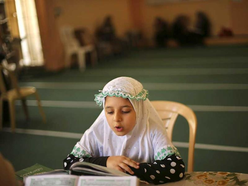 A Palestinian girl takes part in a Koran memorization lesson on the first day of the holy fasting month of Ramadan at a mosque in Gaza. (Reuters photo)