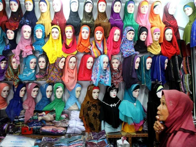 A Muslim woman browses for headscarves at a market in Indonesia. (AP photo)