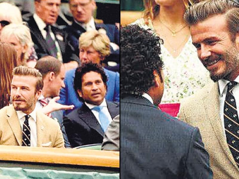 Sachin Tendulkar with football legend David Beckham. The two were spotted at the Wimbledon Championships in London, along with other sports personalities such as Stuart Broad, Andrew Strauss and Ian Poultier. (HT Photo)
