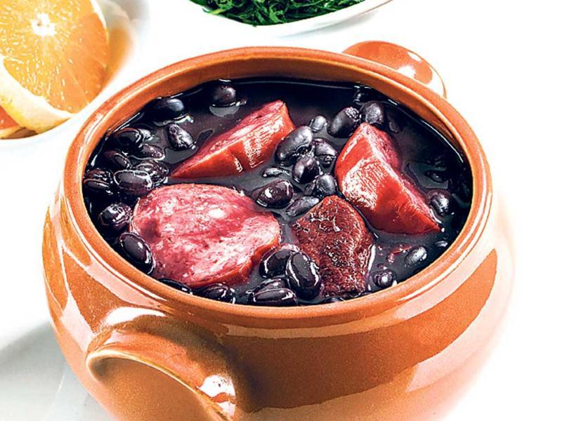 FEIJOADA, Brazil Feijoada is considered to be Brazil's signature item. Served with steamed rice, this mix of beans, pork or beef can be consumed with vegetables too. When making the non-vegetarian dish, the ­vegetables are added towards the end, so they cook on steam. Some stories say that the Feijoada finds its origins in food made by the slaves in some Brazilian districts.
