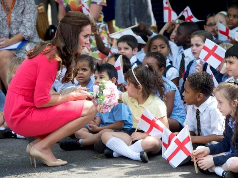 The Duchess of Cambridge stepped out in a crisp red dress for her recent visit to the Blessed Sacrament School here. (AP)