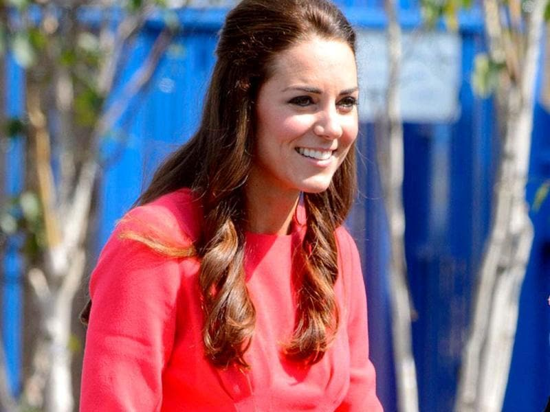 Kate Middleton stepped out in a crisp red dress for a recent visit to a London school. (AP)