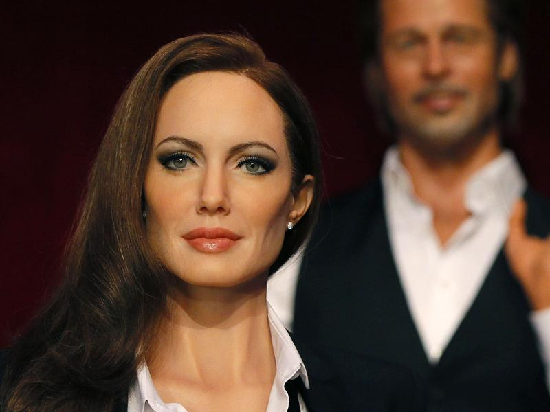 The wax figures of actors Angelina Jolie and Brad Pitt are displayed at the Grevin wax museum during a press presentation in Paris (Reuters Photo)