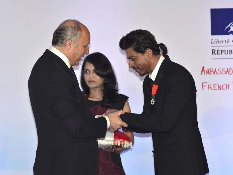 Receiving the Knight of the Legion award, SRK said,