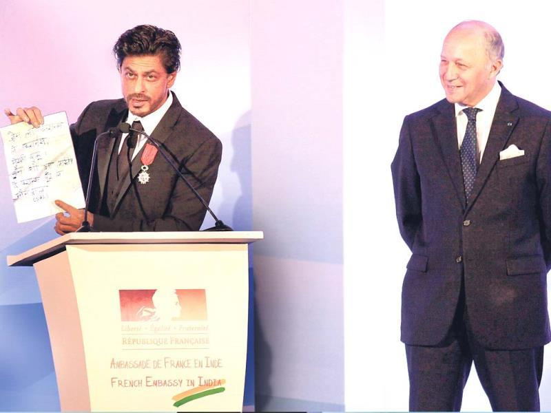 Shah Rukh Khan flaunts his Knight of Legion award, the highest French civillian award.