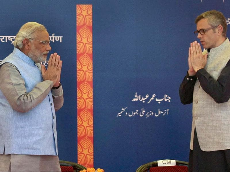 PM Narendra Modi and chief minister of Jammu and Kashmir Omar Abdullah greet at the inauguration of the Katra railway station in Katra, Jammu. (AFP photo)