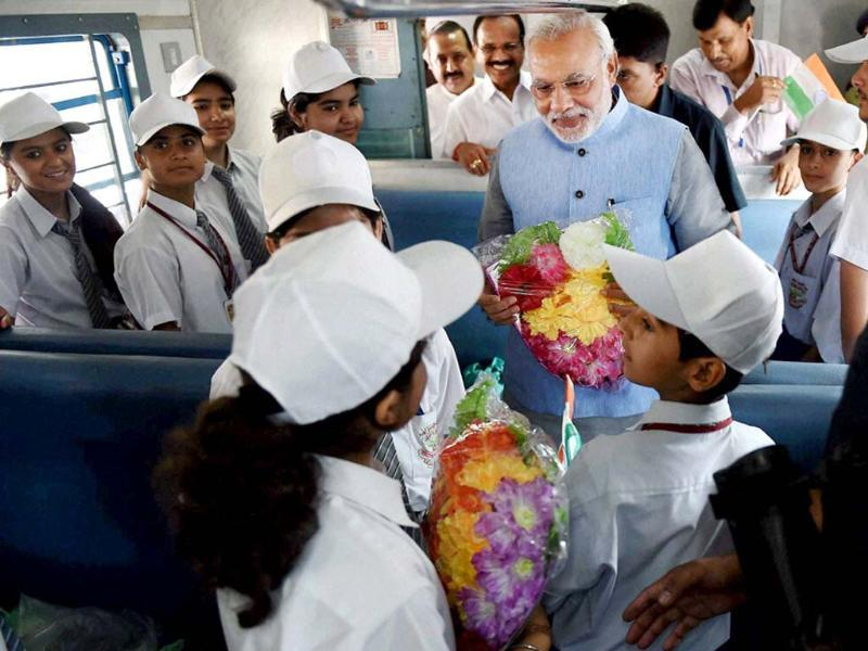 Prime Minister Narendra Modi interacts with children on board the inaugural train on the Katra-Udhampur rail link. (PTI photo)