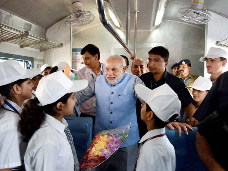 PM Narendra Modi interacts with children on board the inaugural train on the Katra-Udhampur rail link. (PTI photo)