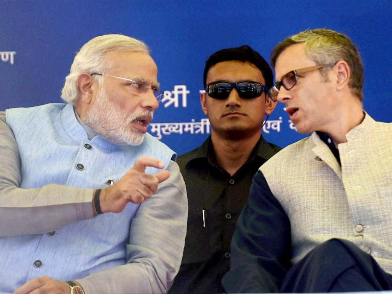 Prime Minister Narendra Modi with Jammu & Kashmir CM Omar Abdullah during the inauguration of Katra-Udhampur rail link, at Katra. (PTI photo)