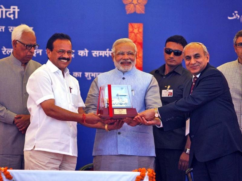 Railway minister Sadananda Gowda, second left, presents a memento to PM Narendra Modi in Katra, 45 kms from Jammu. (AP photo)