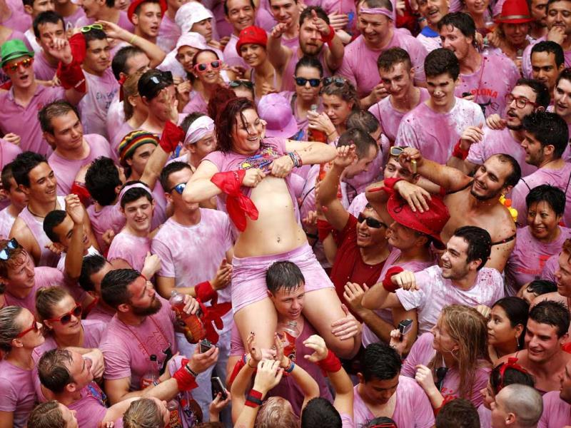 Revelers celebrate during the launch of the 'Chupinazo' rocket, to celebrate the official opening of the 2014 San Fermin fiestas, in Pamplona, Spain (AP Photo)