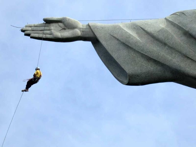 A worker rappels from the Cristo Redentor statue at the Corcovado in Rio de Janeiro. (Reuters)