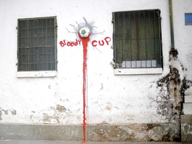 Graffiti is seen in a street of Salvador city. In a project called 'On The Sidelines' Reuters photographers share pictures showing their own quirky and creative view of the 2014 World Cup in Brazil. (Reuters)