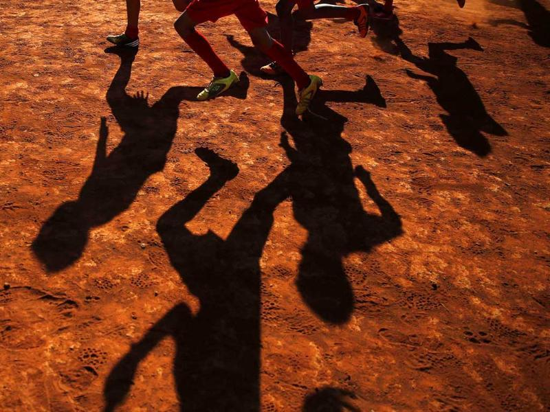 Young players of Planaltina football club practise in Planaltina. In a project called 'On The Sidelines', Reuters photographers share pictures showing their own quirky and creative view of the 2014 World Cup in Brazil. (Reuters)