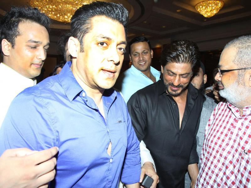 Actors Shah Rukh Khan and Salman Khan during the Iftar Party hosted by Baba Siddique in Mumbai. (IANS)