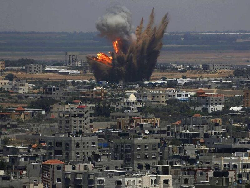 Smoke and flames are seen following what police said was an Israeli air strike in Rafah in the southern Gaza Strip. (Reuters)